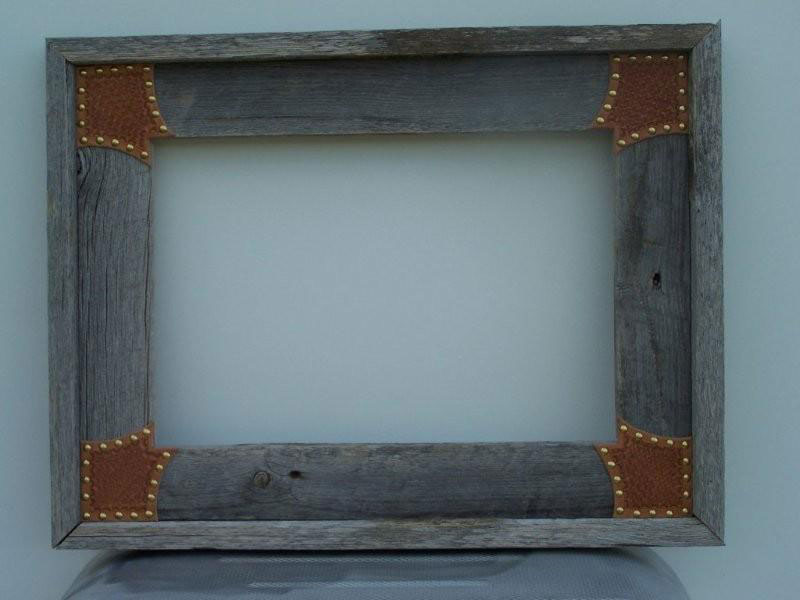 Barnwood picture frames with leather or rawhide accents and corners