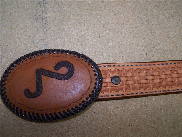 buckles belts and accents in braided rawhide and tooled