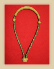 Rawhide bosal, dark body with natural color nose button and heal knot