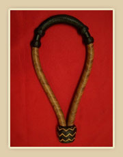 Harness leather, light body with dark nose button and heal knot
