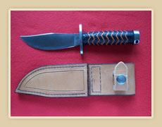New soigné steel blade, with brown and black Kangaroo braided handle