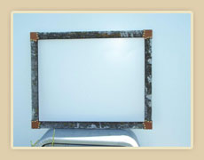 Flat frame with moss and tooled leather wrapped corners