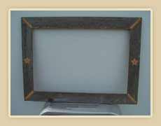 Barnwood frame with braided rawhide corners and leather accents