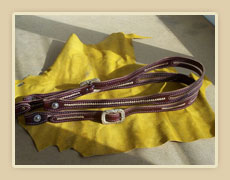 One ear headstalls with rawhide accents and buckles