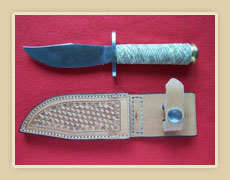 New soigné steel blade, rawhide braided handle