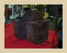 Harness leather saddle bags, with brass spots