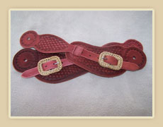 Spur straps with rawhide covered buckles