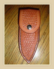 Tooled leather knife sheath